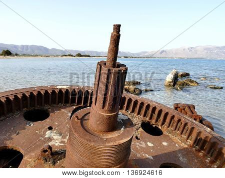 Detail Of Rusted Cogwheel Of Old Ship Stranded On Beach