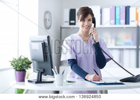 Smiling Receptionist At The Clinic