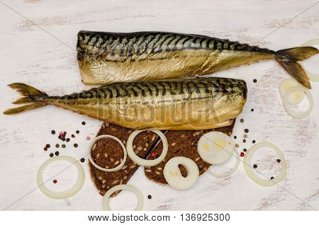 Smoked Fish (mackerel, Scomber) On White Background With Rye Bread