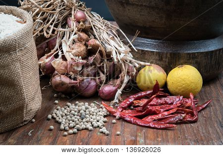 spices many with mortar made of wood on dark wooden table