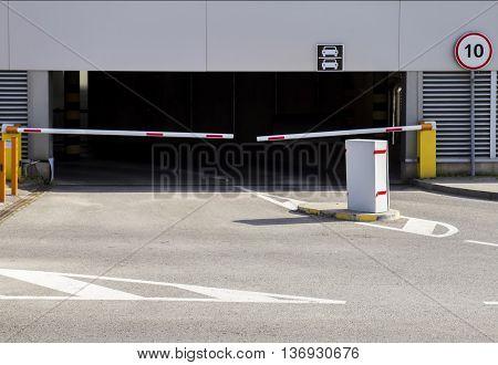 Barrier on the car parking. Parking entrance in business center or supermarket.