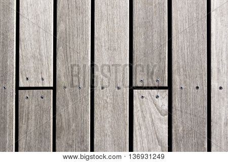 Closeup of a screw screwed into wooden plank. Top view with copy space.