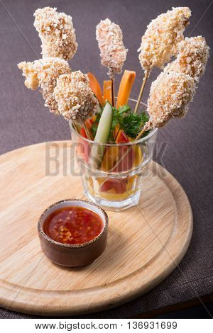 Fried chicken nuggets on a wooden skewers