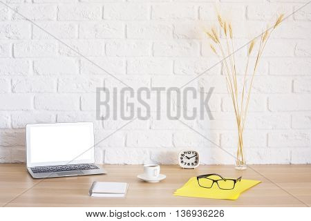 Bright Workplace With White Laptop