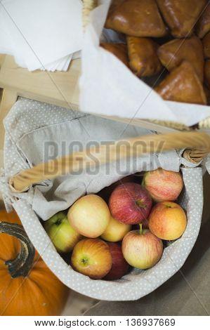 Ripe , juicy, fragrant apples in a wicker basket