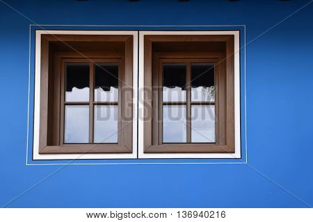 Windows on a blue facade of a Bulgarian traditional house