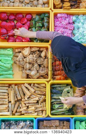 Variety of delicious and colorful Malaysian home cooked local cakes or