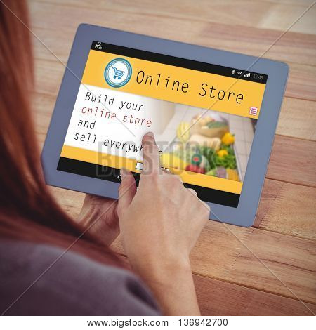 Screen of an online store against over shoulder view of hipster woman using tablet