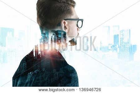 Closeup of stylish businessman in glasses on New York city background with sunlight. Double exposure