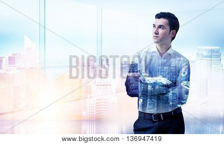 Caucasian businessman with folded arms on New York city background with sunlight. Double exposure