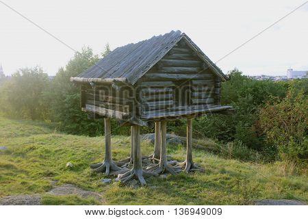 wooden hut on legs. Sweden skansen park.