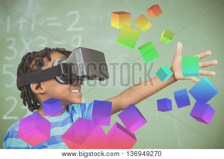 Digitally generated grey cubes floating against school boy in virtual reality glasses in classroom