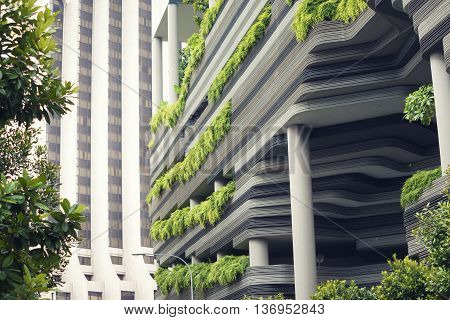 modern skyscraper wall with tropical plants terraces in Singapore city
