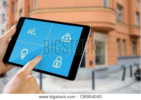 Man using tablet pc against entrance of cafe