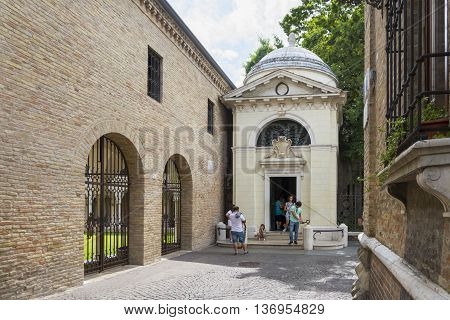 RAVENNA,ITALY-AUGUST 21,2015:people visit the Dante's tomb in Ravenna during a sunny day.