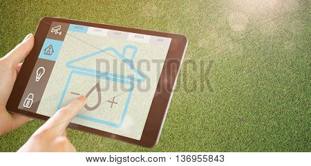 Man using tablet pc against close up view of astro turf