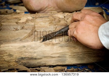 Wood Carver Man Is Using A Wood Chisel To Extract.