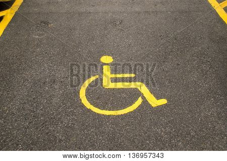 Yellow line cripple sign on park car outdoor