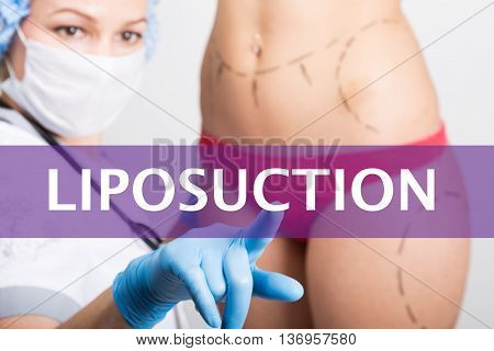 liposuction written on a virtual screen. Internet technologies in medicine concept. medical doctor presses a finger on a virtual screen. cosmetic surgery, lifting and breast augmentation.