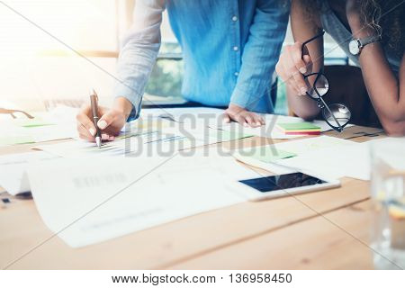 Coworkers Work Process Modern Office Loft.Account Managers Team Produce New Idea Project.Young Business Crew Working Startup.Smartphone Wood Table.Analyze Market Reports.Blurred, Film Effect.Horizontal