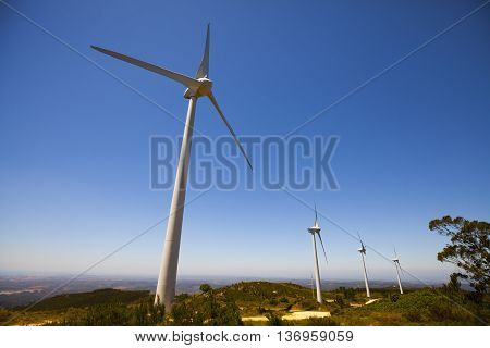 Wind Turbine power generators on the mountain during sunny day