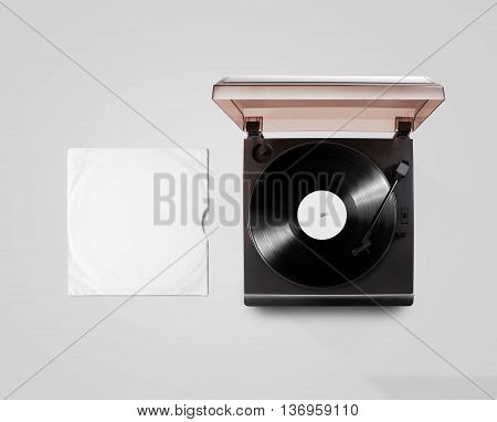 Gramophone vinyl player and record cover sleeve mockup, top view, isolated. Talking machine play blank sound plate mock up. Retro phonograph design from above. Spinning vinyl template audio disc