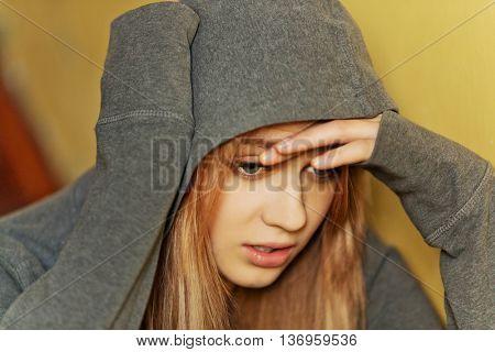 Teenage depressed woman sitting on stairscase