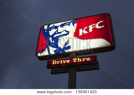 DALLAS Tx USA - APR 17 2016: Logo of a Kentucky Fried Chicken (KFC) fast food restaurant illuminated at night. Dallas Texas United States