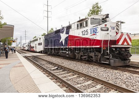 DALLAS USA - APR 18 2016: Trinity Railway Express train (TRE) at the station in the city of Dallas