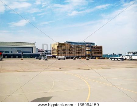 Stuttgart Germany - May 26 2008: Terminal labeled with Stuttfart at Airport Echterdingen - view from inside of airplane runway in front