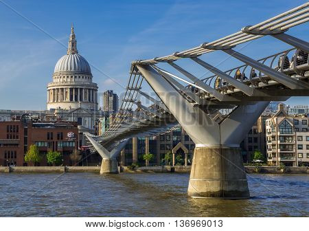 LONDON, UNITED KINGDOM - 3 JUNE 2014: Millenium Bridge crossing the River Thames London with dome of Saint Pauls Cathedral in Background