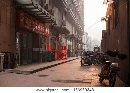 TIANJIN CHINA - APRIL 13: Chinese street at sunset background