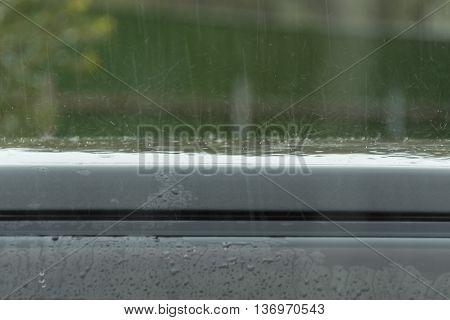 rain drops beat on a car roof.