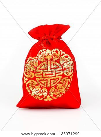 Red Fabric Bag Or Ang Pow With Chinese Style Pattern On White Background.