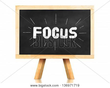 Focus Word With Emphasis Line On Blackboard With Easel And Reflection On White Background,business C