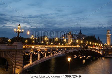 Pont alexandre iii bridge at dusk in Paris France