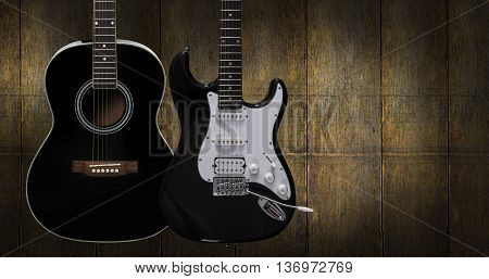 Acoustic and electric guitar on dark red wooden background.