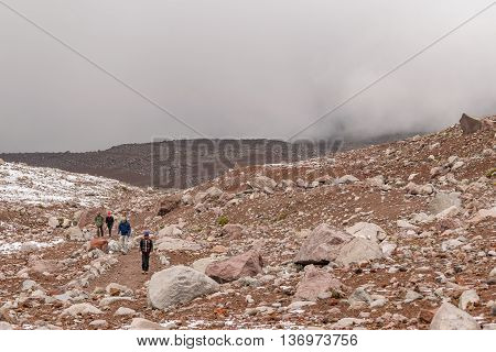 CHIMBORAZO, ECUADOR, OCTOBER - 2015 - People walking to the road which goes to the chimborazo mountain in Ecuador South America