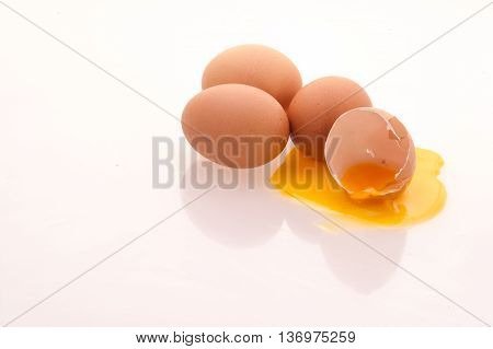 Broken eggs and eggs laid three eggs on a white background.