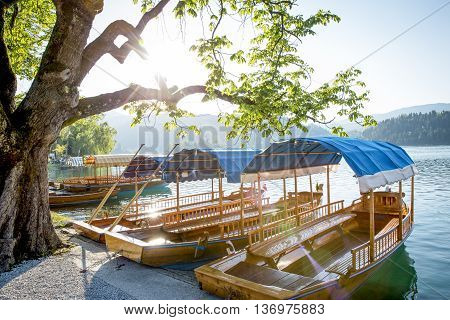 Tourist boats at the shore of Bled Lake in Slovenia