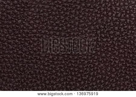 Bright red leather texture background. Closeup photo. Reptile skin. The skin of a crocodile or a snake