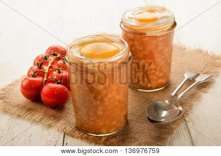 baked beans fried egg in a glass served with spoon