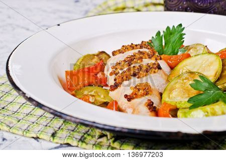 Grilled chicken breast with vegetables. Selective focus.
