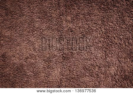 Terry towel texture. Close-up brown material structure may be used as background.