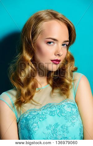 Portrait of a beautiful young woman with evening make-up. Natural shiny make-up with bright lips. Perfect smooth skin. Fashion, cosmetics concept.