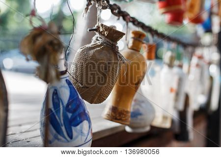 Bottles hanging on the chain. concept of time