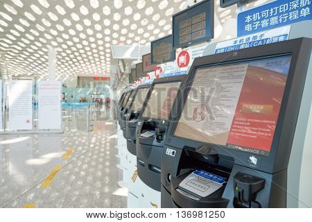 SHENZHEN, CHINA - CIRCA MAY, 2016: self check-in kiosks in Shenzhen Bao'an International Airport. It is located near Huangtian and Fuyong villages in Bao'an District, Shenzhen, Guangdong, China.