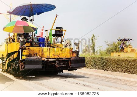 Working road roller or steamroller on the site work street or road amendment and streamroller working in sunny day