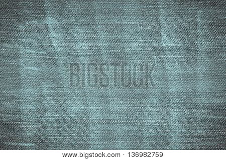 Abstract background of denim material. The texture of jeans trousers.