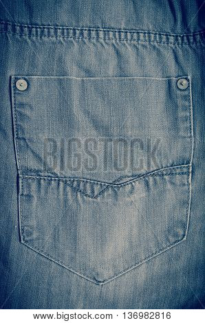 Black jeans pants pocket. Close-up of a denim empty back pocket.